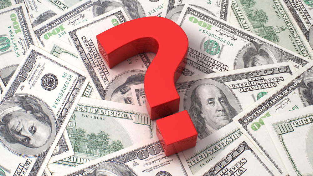 Question mark on a pile of money