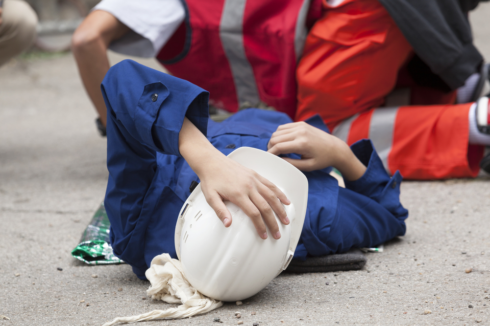 Person holding head after a construction accident