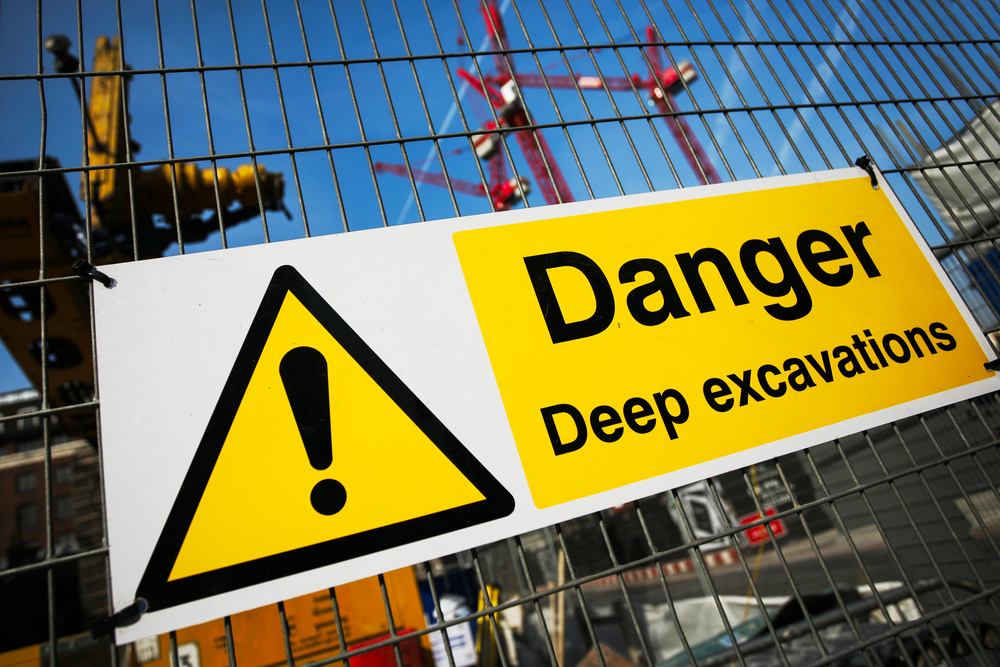 Danger sign on a construction site fence