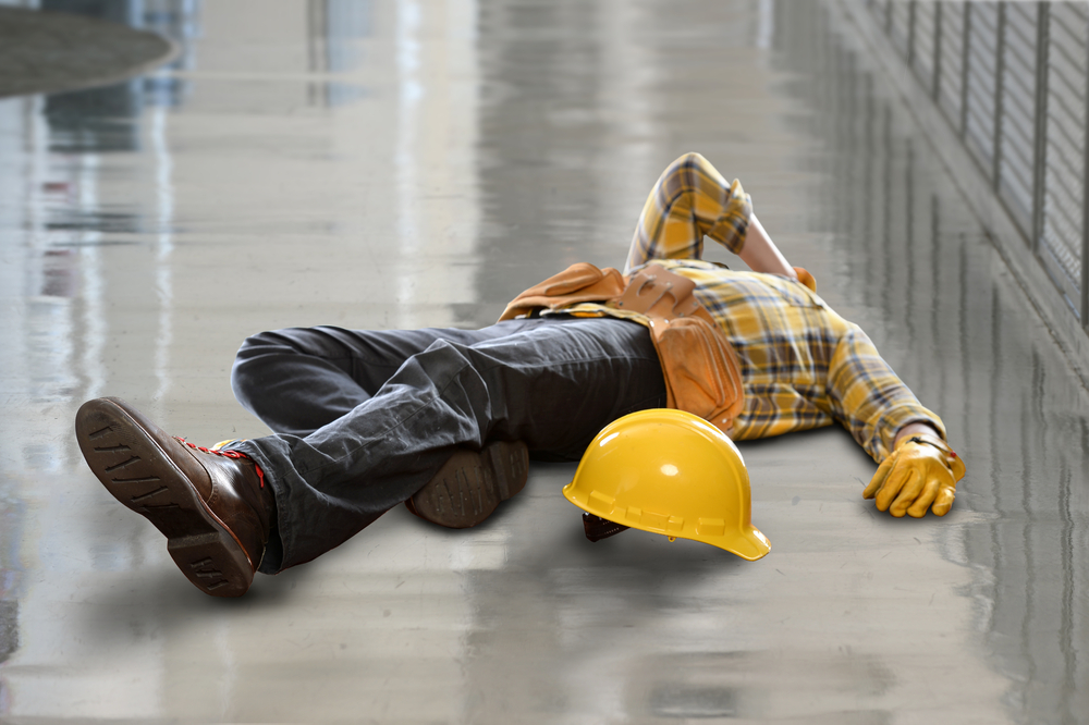 Construction worker lying on the ground