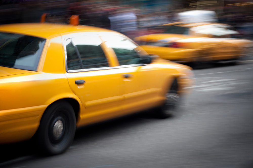 Blurred image of two taxi cabs