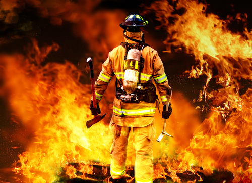 firefighter walking in to flames