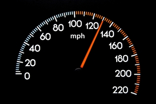 Speedometer showing 130 mph