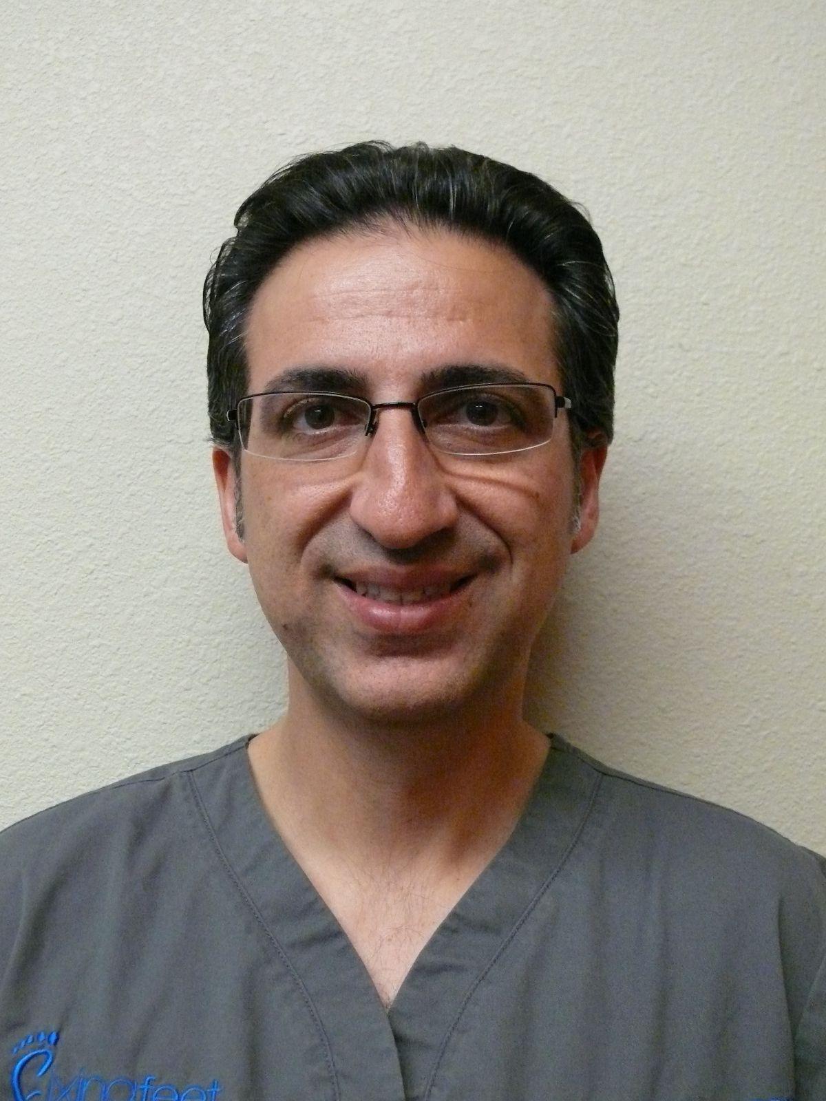 Dr. Peyman Elison