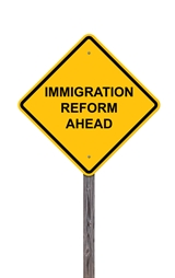 Yellow Immigration Reform Ahead Sign Tucker & Nong