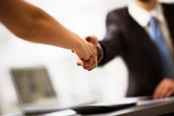 Lawyer and Client Shaking Hands After a Meeting