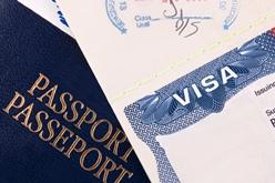 Close-Up View of a VISA and Passport Tucker & Nong