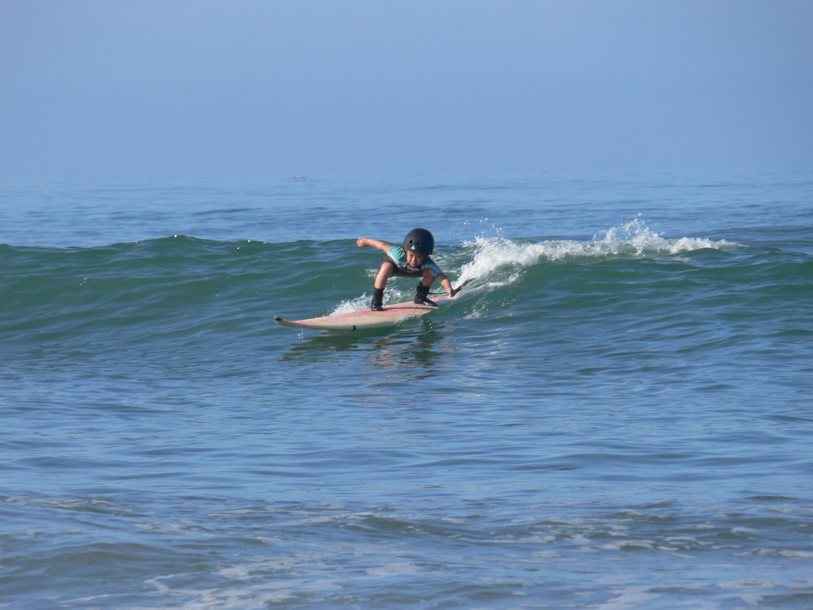 Waian Setting up her bottom turn- Cardiff Reef - 4 years old!