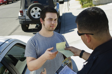 Signing a reckless driving ticket