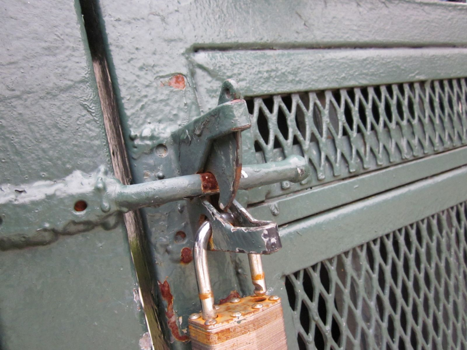 Broken latch on pool gate at slumlord's property