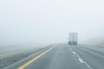 18 wheeler driving into fog bank