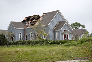 Church With a Damaged Roof After a Strong Storm