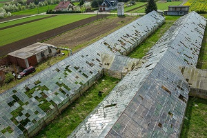 Greenhouse roof has been destroyed by falling hail