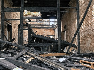 Burnt-out remains of a commercial building after a fire
