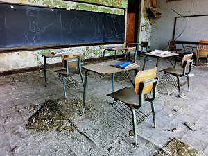 An abandoned classroom has been ravaged by severe weather and neglect