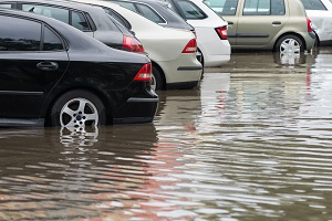 Cars in flooded dealer lot