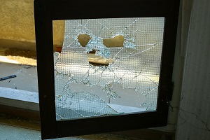 Hotel glass door has been shattered by hail
