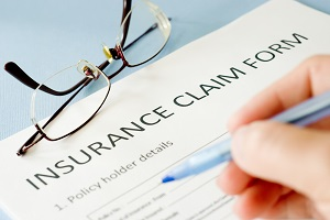 Filling out an insurance claim form for hail damage