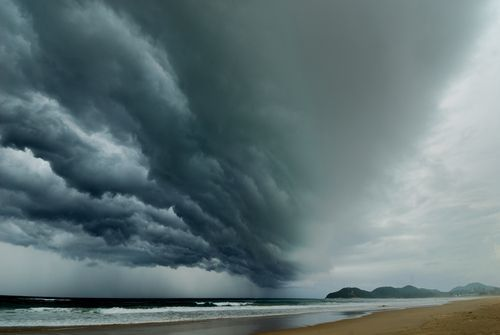 Dark Storm Clouds Forming Over the Beach