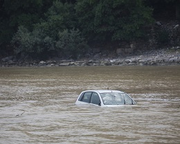 Promptly report damage from a flooded car to your insurance company