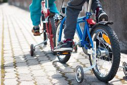 Teach your child safe biking habits for the trip to school.