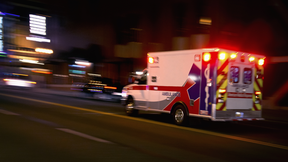 Ambulance speeding down the road