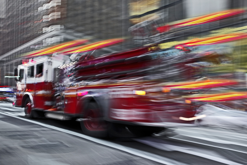 Blurred image of fire truck racing down the street