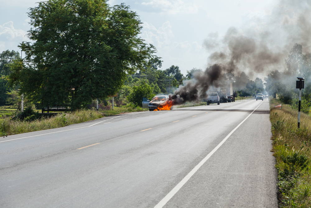 Car burning on the side of the road