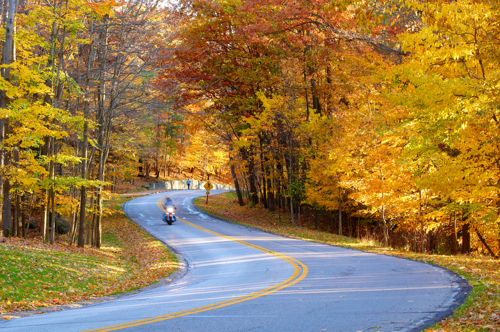 Motorcycle on scenic fall road