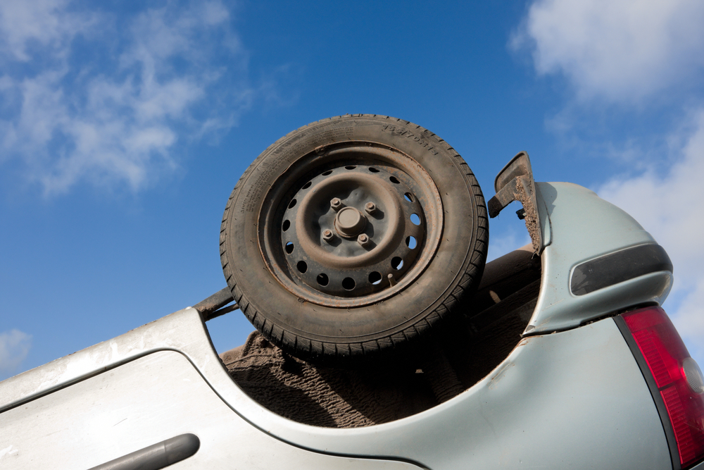 Close-up of tire on upside-down vehicle