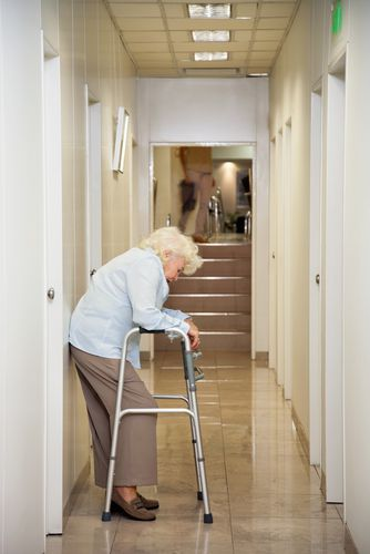 An Elderly Patient in a Hospital Hallway