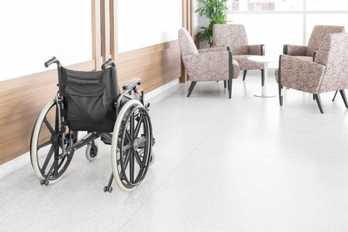 An Empty Wheelchair Sitting in a Nursing Home