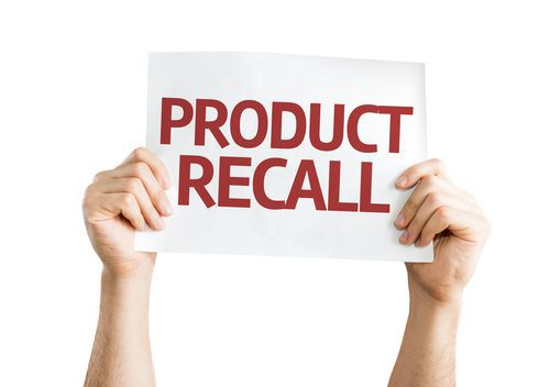 Two Hands Holding up a Product Recall Sign