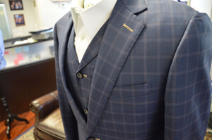 A detail shot of a custom suit jacket from WT Clothiers.