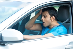 Distraught Driver After a Hit and Run Accident