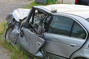 Remnants of a Silver Car After a Head-On Collision